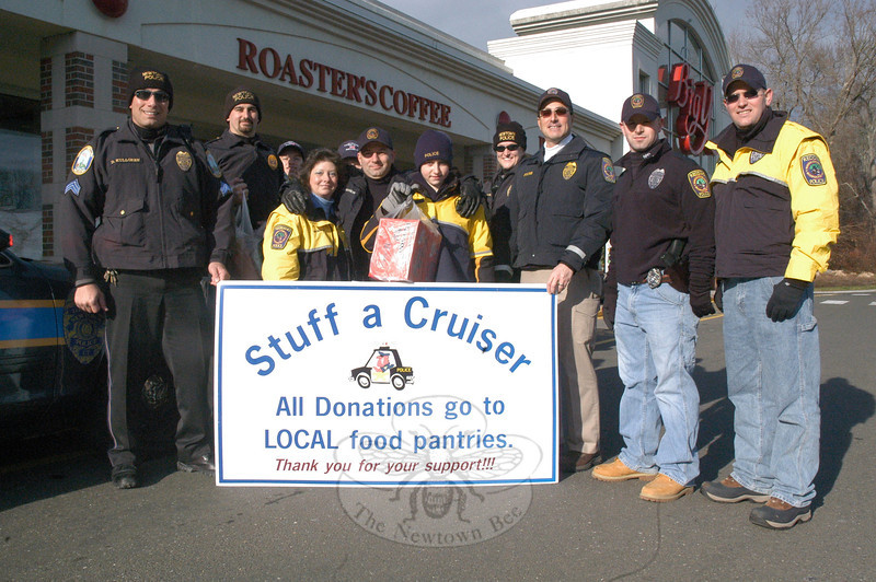 "Newtown and Redding police department members participated in the ""Stuff a Cruiser"" project on Saturday, December 17, in front of the Big Y supermarket at Newtown Shopping Village at 6 Queen Street. The police officers received donations of food, which was given to local food pantries for distribution.  (Gorosko photo)"