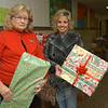 Ann Piccini, director of the Newtown Social Services Department, left, and Ann Benore, the department's case manager, are shown in a Sandy Hook School corridor where hundreds of donated holiday gifts had been stockpiled for delivery to needy local families on December 17.   (Gorosko photo)