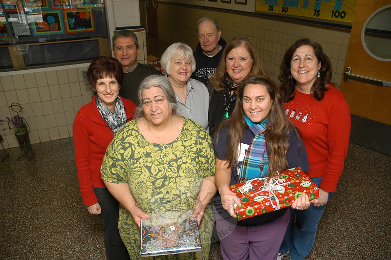 Members of The Newtown Fund held the group's Depot Day activities on Saturday, December 17, at Sandy Hook School. Pictured from left, front row, are Phyllis Zimmer, Max Zimmer; middle row, Doreen Kostecki, Sharon Maynard, Linda Bates, Ann Ragusa; back row, Rick Mazzariello, Don Brooks.  (Gorosko photo)