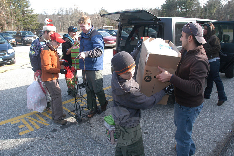 Local Boy Scouts and many others helped load donated holiday gifts for delivery to local families on Depot Day at Sandy Hook School.  (Gorosko photo)