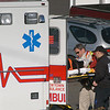 Town emergency services staffers placed a person into an ambulance following a two-vehicle accident on Berkshire Road, near its intersection with Wasserman Way, about 1:43 pm on December 29. Newtown Volunteer Ambulance Corps members and Sandy Hook volunteer firefighters responded to the incident. Motorist Inge Roswell, 43, of 25 Osborne Hill Road, who was driving a 2008 Honda Accord coupe westward on Berkshire Road, stopped suddenly for traffic conditions, after which westbound motorist Vedratna Suyal, 46, of 5 Sand Hill Road, who was driving a 2007 Honda Odyssey minivan, struck the rear end of the Accord coupe, police said. Roswell was injured in the accident. Police verbally warned Suyal for following too closely.                           —Bee Photo, Gorosko