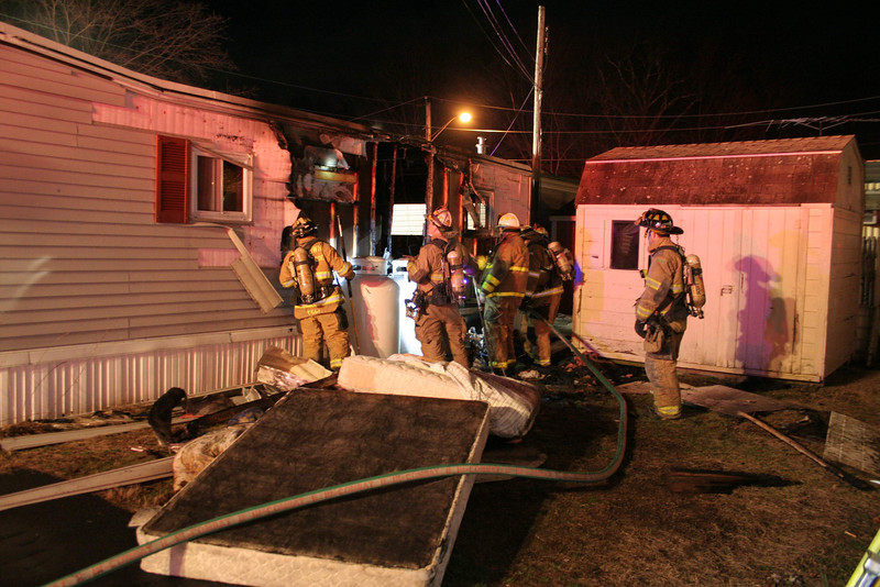 Volunteer firefighters from across town responded on the evening of Monday, January 2, to a fire that heavily damaged Unit 23 at Newtown Village Mobile Home Park at 301 South Main Street (Route 25) in Botsford. Fortunately, the address is near the Botsford firehouse, which contained some fire company members at the time of 5:06 pm call. No one was at home when the accidental fire occurred. There were no injuries.  —Bee Photo, Hicks