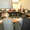 "Councilman Robert Merola, far right corner, asks First Selectman Pat Llodra, left foreground, a question during the Legislative Council's first meeting of the new year. During the relatively brief gathering on January 4, the panel learned about a school district capital appropriation request, reviewed and accepted a set of ""guiding principles,"" scheduled a forum to meet Newtown's four state lawmakers, as well as finalized each council committee's makeup and leadership. —Bee Photo, Voket"