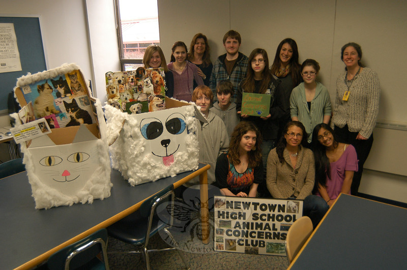 Members of the Newtown Animal Concerns Club donated $50 to The Animal Center of Newtown on Monday, January 30. The Animal Center's Monica Roberto, bottom center, and Leyla Nichols, back row, third from right, attended the meeting to receive the donation. —Bee Photo, Hallabeck