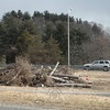 An SUV travels on the Exit 11 on-ramp for Interstate 84 this week near some piled brush and trees that recently were cut in that area by the state Department of Transportation (DOT). The DOT did extensive vegetation cutting along the mainline of the highway near Exit 11, and also along the interchange's on-ramps and off-ramps.               —Bee Photo, Gorosko