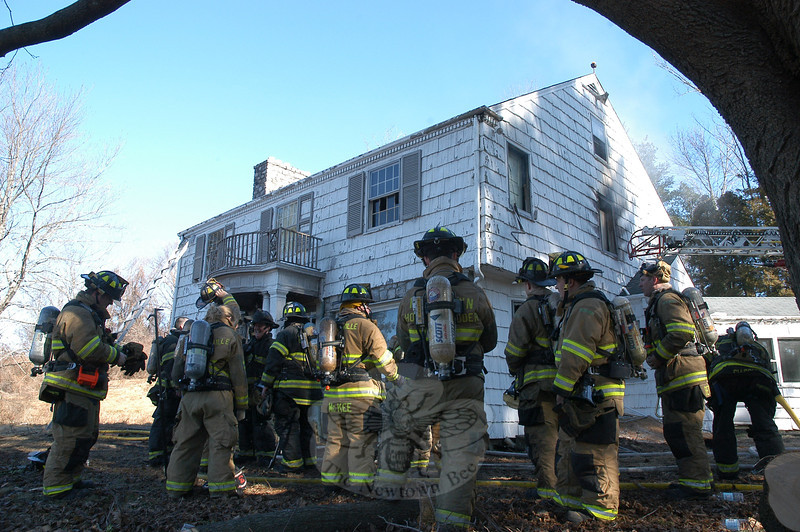 About 45 volunteer firefighters participated in a fire training session last Saturday. Sections of a vacant house on Mt Pleasant Road were ignited to create realistic firefighting conditions. —Bee Photo, Gorosko