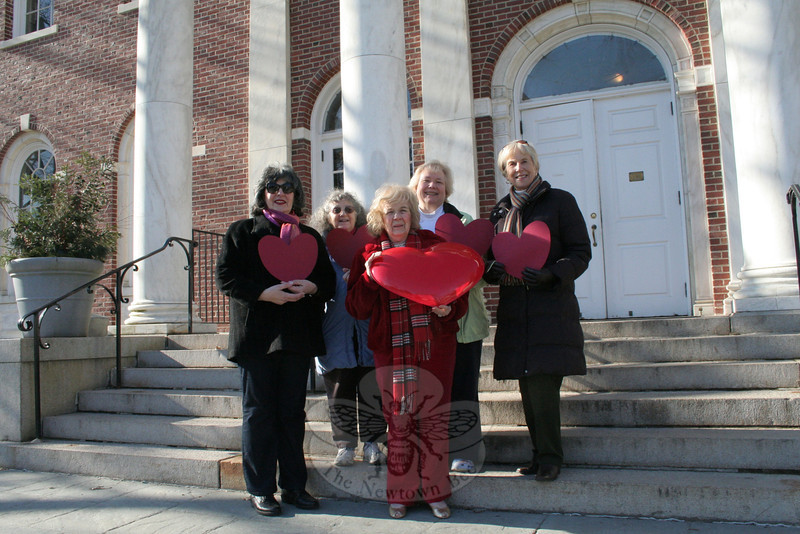 The members of Newtown VNA will be setting up a table at Newtown Municipal Center by the end of this week, to remain on view all month, with information related to achieving and maintaining a healthy heart for men and women. The ladies are doing this part in honor of Friday, February 3, being designated by the American Heart Association National Wear Red Day. Men and women can support the fight against heart disease in women — the leading killer of women — by wearing red. This simple gesture has helped AHA raise crucial awareness and significant funds in the fight against heart disease and stroke in women since 2002. February has also been designated, by the Centers for Disease Control and Prevention, as American Heart Month. Meanwhile, VNA members were gearing up for Wear Red Day by gathering this week on the steps of Edmond Town Hall, home to the VNA Thrift Shop. From left is Toni Catalina, Betty Warner, Mae Schmidle, Anna Wiedemann, and Margareta Kotch. —Bee Photo, Hicks