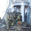 About 45 volunteer firefighters participated in a fire training session on Saturday, January 28. Sections of a vacant house on Mt Pleasant Road were ignited to create realistic firefighting conditions. —Bee Photo, Gorosko