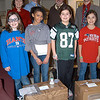 From left, front row, Respect, Responsibility, and Diversity (RRD) Club members Annie Davidow, Zoe Yllanes, Taylor McPadden, and Lindsay Dievert stand with, back row, Middle Gate Lead Teacher Susan Ruddock, RRD Club Advisor Brian Kowalsky, Hawleyville Postmaster Mark Favele, and Middle Gate Elementary School Principal Chris Geissler on Friday, February 3, with boxes the school prepared for this year's Valentines For Troops effort. —Bee Photo, Hallabeck