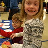Ava Burns, right, and brother Evan decorated cookies at one of the multiple stations set up in Hawley Elementary School's gymnasium on Thursday, February 2, for the school's Dessert Night.    —Bee Photo, Hallabeck