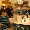 One of Cathy Cincogrono's classes at Newtown Middle School, stood with cards and goods assembled for Andrew Buonocore, who is serving with the Marines in Afghanistan, on Thursday, February 2. Andrew's brother, eighth grader Cooper Buonocore, sits in the left foreground. 	   	   —Bee Photo, Hallabeck