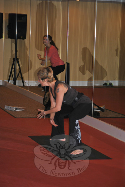 Instructor Deidre Americo demonstrates the Les Mills Body Flow program, combining movements from yoga, tai chi, and Pilates, at a January 28 introductory class at Club NewFit. —Bee Photo, Crevier