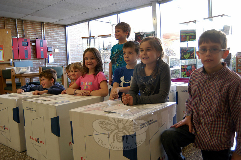Sandy Hook School second graders pose Friday, February 3, with boxes prepared by the school for this year's Valentines for Troops effort. —Bee Photo, Hallabeck
