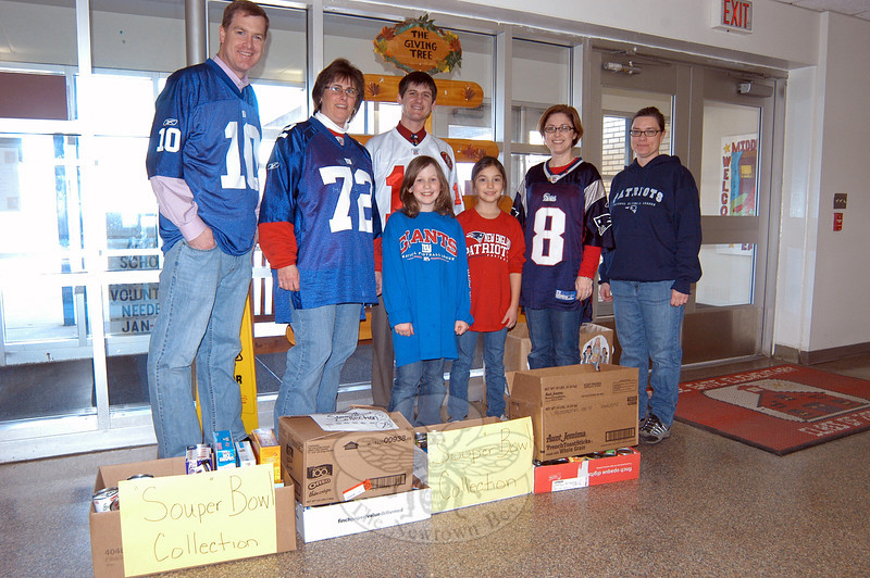 "Faculty and students at Middle Gate Elementary School stood together on Friday, February 3, in football jerseys to help promote the school's ""Souper"" Bowl food drive. 						        —Bee Photo, Hallabeck"