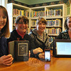 From left, C.H. Booth Reference Librarian Andrea Zimmermann, Technical Services Librarian Brenda McKinley, Library Director Janet Woycik, and Children's Librarian Alana Bennison display just a few of the many devices on which library patrons will soon be able to borrow e-books.	                                                                                                —Bee Photo, Crevier