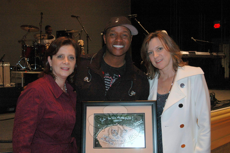 Before he became the Season 1 winner of NBC's The Voice, Connecticut resident Javier Colon was the featured opening ceremonies entertainment at the 2009 and 2010 Newtown Relays For Life. Current Relay Chair Michelle Babyak and former chair Lynda Russo caught up with the artist during a recent Ridgefield Playhouse show, to present him with a commemorative aerial photo of cancer survivors forming the word HOPE at Newtown's 2010 event. —Bee Photo, Voket