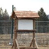 Tarren Horvath has built an information kiosk for use by Victory Garden volunteers as his Eagle Scout Project. Constructed primarily from cedar, the sign-board is portable and has a shingled roof over a message area.       —Bee Photo, Bobowick
