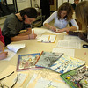 Newtown Middle School seventh grade students, from left, Bridget Spies, Pip Gamble, Rian Frate, and Keira Veillette worked on the school's upcoming 2012 edition of Opus Optima after school on Tuesday, February 7.	—Bee Photo, Hallabeck