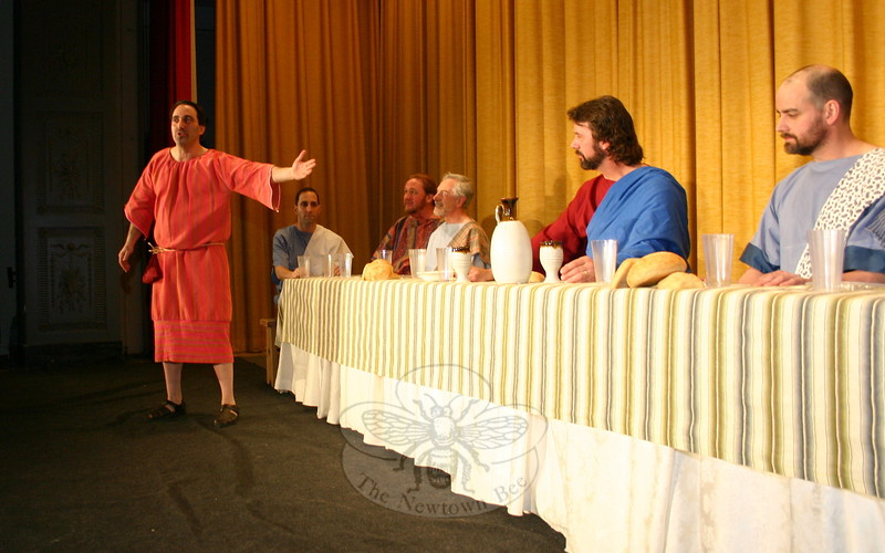 During the presentation of The Last Supper Enactment, each of Jesus's 12 Apostles, including Judas Iscariot, left (being portrayed by Alexis M. Vournazos), offers a monologue. —Bee Photo, Hicks