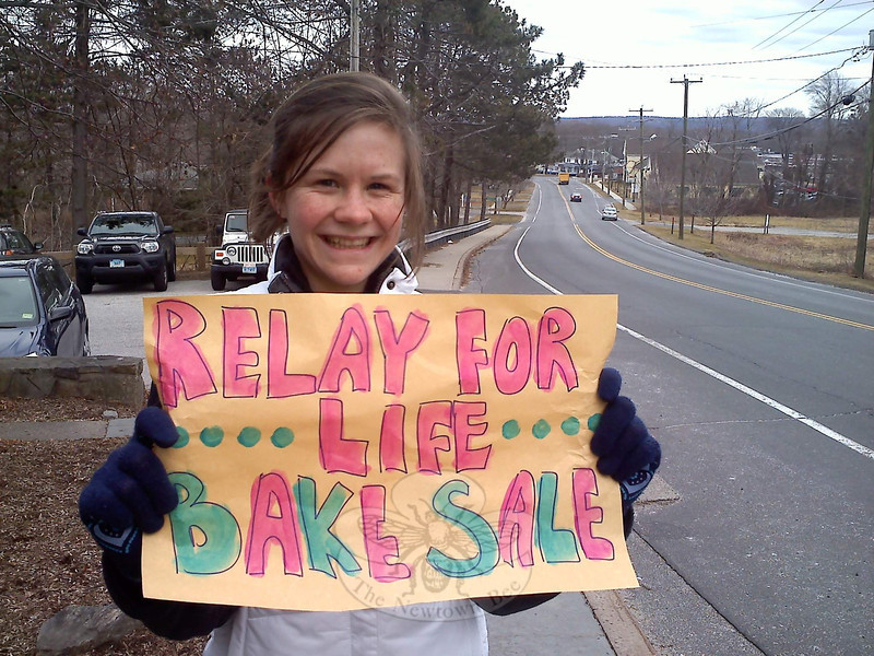 "Emily Ashbolt, a former Newtown Bee intern, drummed up attention for a bake sale she and her Relay For Life team, Sole Savers (""we're runners,"" she said by way of explanation), hosted on February 21. The sale of fresh baked goodies was an early fundraising effort toward the American Cancer Society event that returns on June 1 to Fairfield Hills.  —Bee Photo, Hicks"