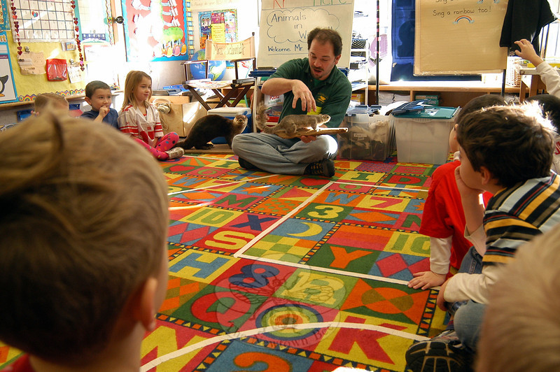 Henryk Teraszkiewicz, center, visited his daughter Zosra's Middle Gate Elementary School kindergarten class on Friday, February 3, to speak to the students about how animals survive through the winter. Mr Teraszkiewicz works for Woodcock Nature Center in Wilton.					           —Bee Photo, Hallabeck