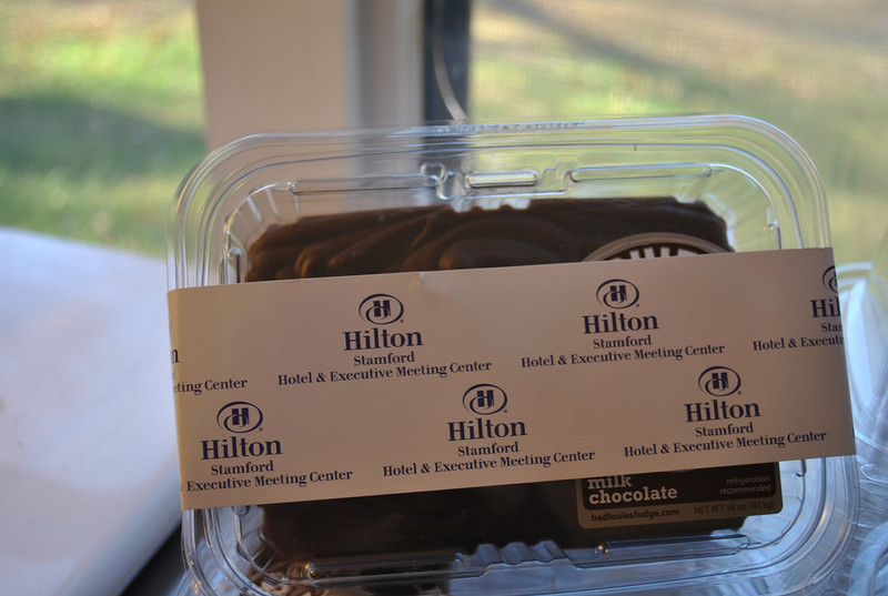 "Mr Cocozza provides corporate ""belly bands"" for companies that wish to use Bad Louie's Fudge as a promotional gift. Here, a ""belly band"" for Hilton Hotel wraps around a one-pound container of Bad Louie's Fudge.  (Crevier photo)"