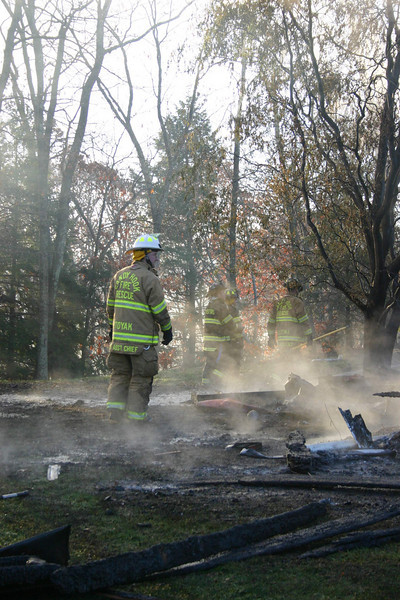 Sandy Hook Volunteer Fire & Rescue Company First Assistant Chief Kevin Stoyak is shown among the ruins of a house fire that occurred early Sunday morning at Zoar Ridge Stables at 5 Morgan Drive in Sandy Hook.  (Bee Photo, Hicks)