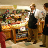 Newtown Congregational Preschool students, relatives and chaperones visited the Newtown Big Y on Wednesday, November 10. Big Y's Amanda Bryda acted as the group's hostess during the visit, and, above, Dan Becea, left, and Dave Phillips gave the group a tour of Big Y's produce section. The preschoolers were also given a tour of the store's bakery, seafood section, and learned how to make pizza. After the tour, the preschoolers shopped for items to donate to Newtown Social Services.  (Hallabeck photo)
