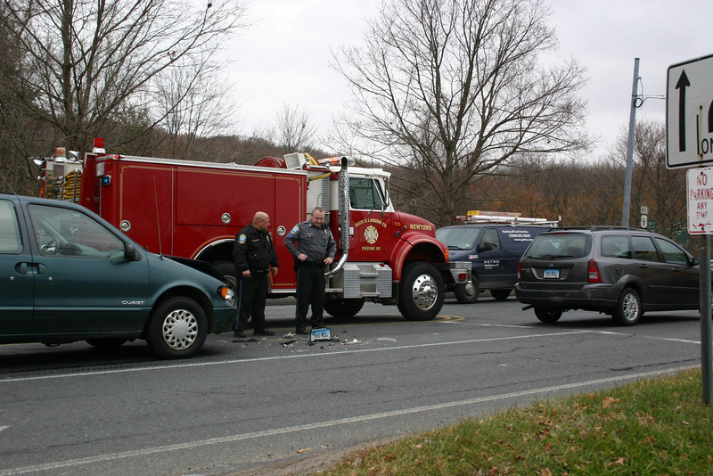 A two-vehicle accident occurred on eastbound Church Hill Road at its intersection with the Exit 10 ramps for Interstate 84 about 1 pm on November 15. Police said motorist Patricia LaForte, 74, of Brookfield, who was driving a 2007 Ford station wagon, was stopped in the eastbound straight-ahead lane when the Ford was struck from behind by an eastbound 1997 Nissan minivan driven by Zuzana Judakova-Jaros, 47, of 43 South Main Street. LaForte was transported to Danbury Hospital to be checked for a pain complaint. Hook & Ladder firefighters responded to the accident. Police issued Judakova-Jaros an infraction for following too closely.  (Hicks photo)