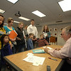 Bruce Degen met father and son Bruce and Deagan Granville while he signed books at the library on Saturday, November 6. Deagen Granville and his brother Collin, the two boys on the right in stripes, hold hands with their father, Bruce, behind them.  (Bobowick photo)