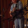 Performer Tom Chapin sings one of his satirical folk songs Saturday, November 6.  (Bobowick photo)