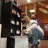 "Chris Van Steen, co-owner of Cork N Barrel, stocks wine at his Plaza South package store in Newtown. He and his partner, Wayne Duris shared the opinion of several other local liquor store owners who are welcoming a proposed change in state Blue Laws that would permit alcohol sales on Sunday.  (Voket photo)<br /> <br /> Read more here:<br /> Local Retailers Brace For Reform Of Liquor Laws<br />  <a href=""http://newtownbee.com/2012-03-01__13-08-39"">http://newtownbee.com/2012-03-01__13-08-39</a>"
