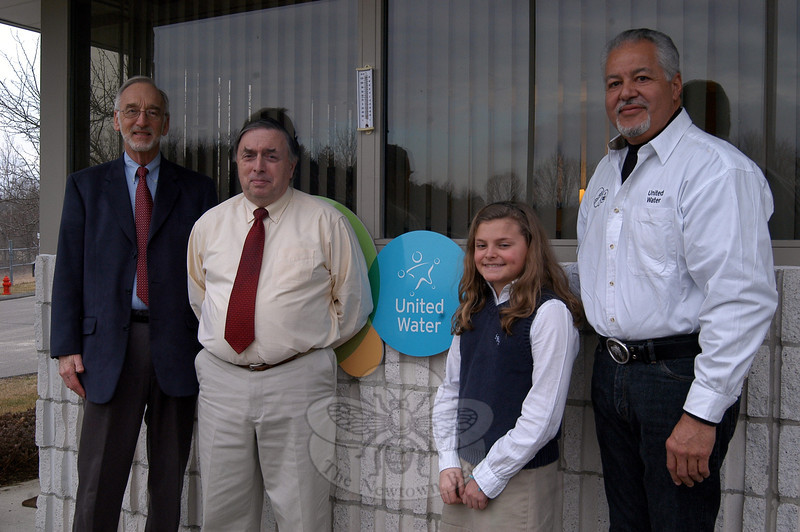 From left, Water and Sewer Authority Chair Richard Zang, Director of Public Works Fred Hurley, St Rose of Lima sixth grader Grace Herrick, and United Water Plant Manager Julio Segarra stand together outside United Water on Commerce Road. Grace was among a number of Newtown students who were recently recognized for their efforts in the regional level of the Science Horizons science fair, held over the weekend of February 10 at Western Connecticut State University. She won first place in the junior physical science competition.  (Hallabeck photo)