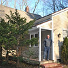 "Art Bauer stands on the porch of what was once the Pohtatuck School. After purchasing the house, badly in need of repairs, in 1984, he came to know more about the history of the building. The porch was added by Mr Bauer to what was the original 18th Century school room.  (Crevier photo)<br /> <br /> Read more about Mr Bauer's home here:<br /> Life In The Schoolhouse In The Glen<br />  <a href=""http://newtownbee.com/2012-03-01__13-52-37"">http://newtownbee.com/2012-03-01__13-52-37</a>"