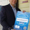 "Realtor Andy Sachs of the Around Town Team displays a poster he is about to hang at Carminuccio's Pizza, one of nearly two dozen local participants in a free business promotion co-op called ""Deals Around Town.""  (Voket photo)<br /> <br /> Read more here:<br /> Realtor Linking To Local Merchants With ""Deals Around Town""<br />  <a href=""http://newtownbee.com/2012-03-01__13-12-53"">http://newtownbee.com/2012-03-01__13-12-53</a>"