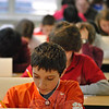 Jake Wilson, a seventh grader at Newtown Middle School, gets started on the first of six math questions at the Fairfield County Math League Meet, hosted Tuesday, February 14, at Newtown Middle School. Students in grades 6-8 from Newtown Middle School, Reed Intermediate School, Broadview Middle School in Danbury, East Ridge Middle School in Ridgefield, Rogers Park Middle School in Danbury, and Whisconier Middle School in Brookfield took part in the meet, which Newtown won with a score of 28 points.  (Crevier photo)