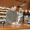 "Wayne Duris checks out a delivery receipt at the counter of Cork N Barrel, one of the many Newtown liquor stores that could opt to be open on Sundays if Governor Dannel Malloy's proposal to repeal one of Connecticut's most notorious Blue Laws is successful.  (Voket photo)<br /> <br /> Read more here:<br /> Local Retailers Brace For Reform Of Liquor Laws<br />  <a href=""http://newtownbee.com/2012-03-01__13-08-39"">http://newtownbee.com/2012-03-01__13-08-39</a>"