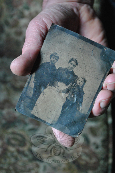 """This tintype photograph is the only artifact Mr Bauer has found in more than 25 years of remodeling the former Pohtatuck School. He cannot be sure, but he believes it could be a picture of a school teacher and students. (Crevier photo)<br /> <br /> Read more about Mr Bauer's home here:<br /> Life In The Schoolhouse In The Glen<br />  <a href=""""http://newtownbee.com/2012-03-01__13-52-37"""">http://newtownbee.com/2012-03-01__13-52-37</a>"""