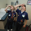 Kevin Curry, left, and Stephen Sedensky tip their heads back and pinch, demonstrating a good way to stop a bloody nose. —Bee Photo, Bobowick