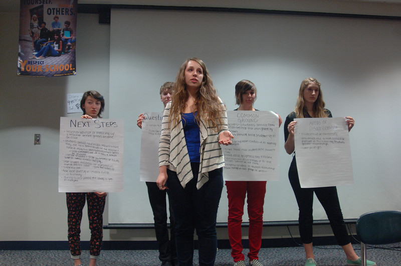 Dana Greenfield discusses her group's conclusions following the day's Community Conversation About Education. Behind her, from left, are Jill Lyon, Adam Oberg, Bethany DuBois, and Rachel Karnoff. —Bee Photo, Bobowick