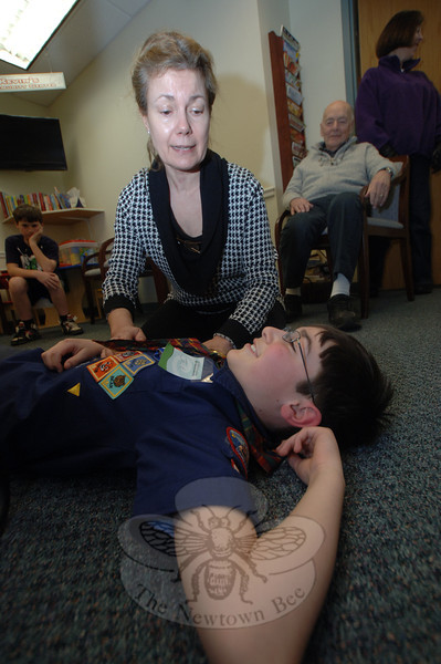 Volunteer Micheline Williams offered CPR demonstrations and tips for what to do in case of a collapse or seizure. Boy Scout Jack Boushie assisted. —Bee Photo, Bobowick