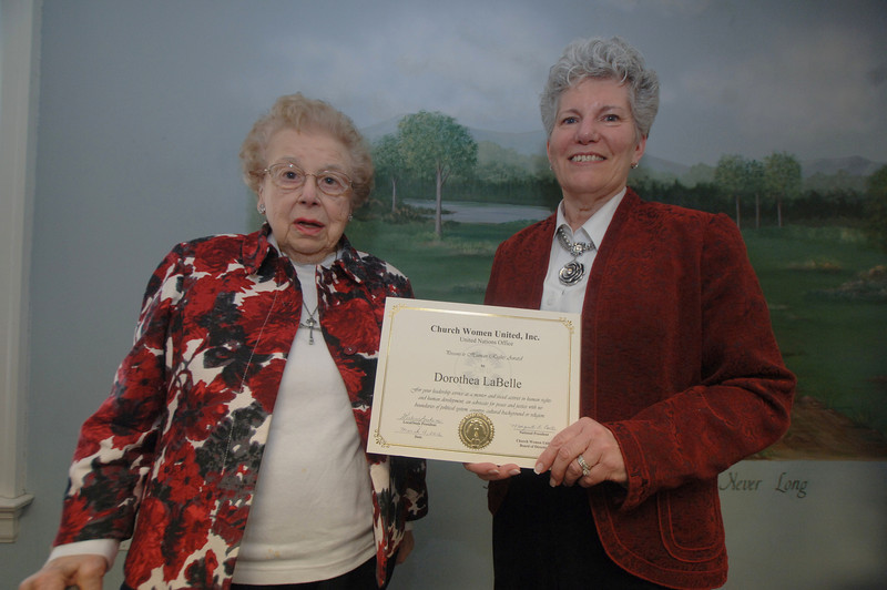 """Church Women United Inc of Newtown honored Dorothea LaBelle, left, with the Human Rights Award of 2012. Linda Manganaro handed Ms LaBelle the certificate during a CWU celebration on Sunday, March 11. Recipients and nominees are """"people who have made a difference in the world and in the lives of others,"""" Ms Manganaro explained. Ms LaBelle, who has worked with the disabled, was """"very happy and surprised"""" to receive the award, she said. The Human Rights Award is for leadership and service as a mentor and activist in human rights and development, as an advocate for peace and justice with no boundaries of political system, country, cultural background or religion. —Bee Photo, Bobowick"""