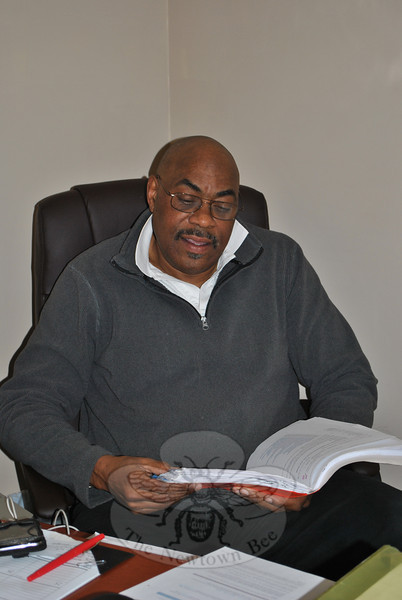 Owner and director of the Center For Therapeutic Massage & Athletics, Inc (CTMA) Ron McKnight reviews patient information in his office at 143 Mt Pleasant Road. The CTMA relocated to Newtown from Bethel in mid-February.	—Bee Photo, Crevier