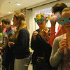 With handmade masks at the ready, Newtown High School students studying all levels of French celebrated Mardi Gras/Carnavale on Thursday, March 1. Students lined up to have their masks judged by their peers, and the winners of the judging earned chocolate coins.  Students also prepared food for the special celebration at NHS.           —Bee Photo, Hallabeck