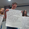 Sydney Hansen, Ian Lew, and Rebecca Dutsar display their group's thoughts during Saturday's conversation among Newtown High School students. —Bee Photo, Bobowick