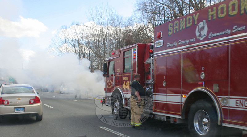 Sandy Hook and Hook & Ladder volunteer firefighters were dispatched to a car fire on eastbound Interstate 84,  just east of the Exit 10 on-ramp, about 1:10 pm on March 20. Some type of malfunction in the 2007 Ford Focus that was being towed from its rear bumper as a junk car by a hook-style wrecker caused the Ford to ignite, said Sandy Hook Fire Chief Bill Halstead. Firefighters used water and foam to extinguish the blaze. Eastbound I-84 traffic slowed during the incident. State police provided no specifics on the incident, but said that there were no injuries or enforcement actions taken. —Bee Photo, Hicks