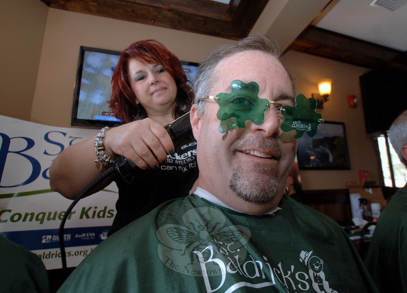 """Event organizer Michael Connors was one of the first volunteers to sit down for a full head shave during the March 18 St Baldrick's fundraiser at McGuire's Ale House.—Bee Photo, Bobowick<br /> <br /> Read more here:<br /> Going Bald For St Baldrick's Raises Thousands Of Dollars<br />  <a href=""""http://newtownbee.com/2012-03-22__17-22-13"""">http://newtownbee.com/2012-03-22__17-22-13</a>"""