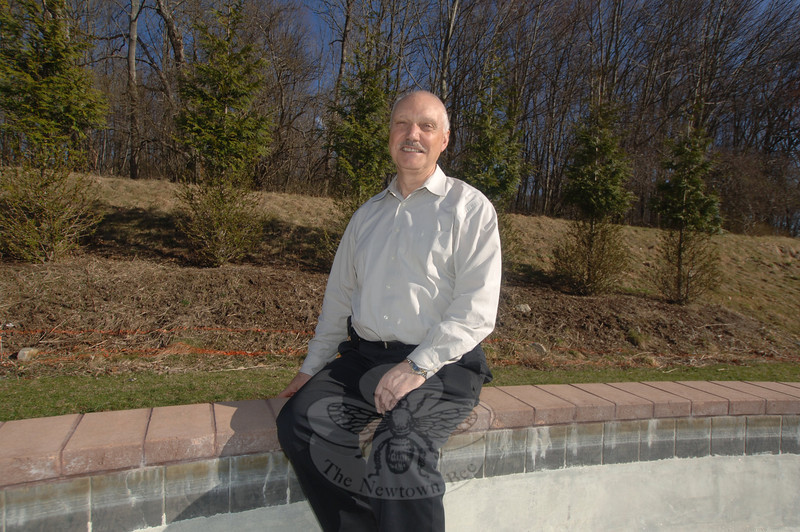 "Newtown Youth Academy (NYA) founder Peter D'Amico sits on the rim of a large fountain in the courtyard behind NYA. The hillside behind him will soon be home to native plantings as part of a Veterans Honor Garden, which will include pavers honoring veterans past, present, and future. —Bee Photo, Bobowick<br /> <br /> Read more here:<br /> Plans For A Veterans Honor Garden Continue<br />  <a href=""http://newtownbee.com/2012-03-22__13-42-13"">http://newtownbee.com/2012-03-22__13-42-13</a>"