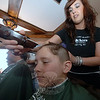 """Jordan Conrad holds still while Jennifer Calandrino of Klicker's Hair Studio gives him a quick buzz cut during at St Baldrick's event at McGuire's Ale House on March 18.—Bee Photo, Bobowick<br /> <br /> Read more here:<br /> Going Bald For St Baldrick's Raises Thousands Of Dollars<br />  <a href=""""http://newtownbee.com/2012-03-22__17-22-13"""">http://newtownbee.com/2012-03-22__17-22-13</a>"""