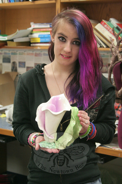 "Newtown High School sophomore Ashley Roswell tried singing, acting, dancing and sports before finally discovering that she is very good at art. The work she is holding in her hands, ""Calla Lila Mug,"" started life as a high school art class assignment earlier this school year. This month the delicate work is on its way to Seattle, where it will be down as one of the works accepted into an annual exhibition that celebrates the best work of young artists in grades K-12. —Bee Photo, Hicks<br /> <br /> Read more here: <br /> Ceramic Interpretation Of A Calla Lily: Ashley Roswell's Work Accepted Into National Student Exhibition<br />  <a href=""http://newtownbee.com/2012-03-21__18-08-36"">http://newtownbee.com/2012-03-21__18-08-36</a>"